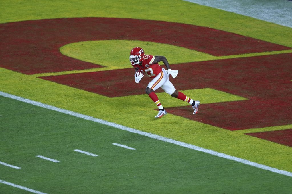 Kansas City Chiefs wide receiver Mecole Hardman (17) runs the opening kickoff from the end zone in Super Bowl LIV at Hard Rock Stadium.