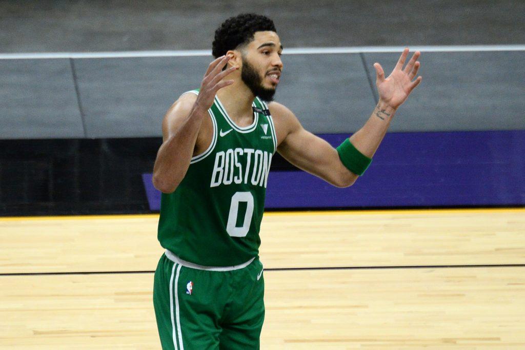 Boston Celtics forward Jayson Tatum (0) looks on against the Phoenix Suns during the second half at Phoenix Suns Arena
