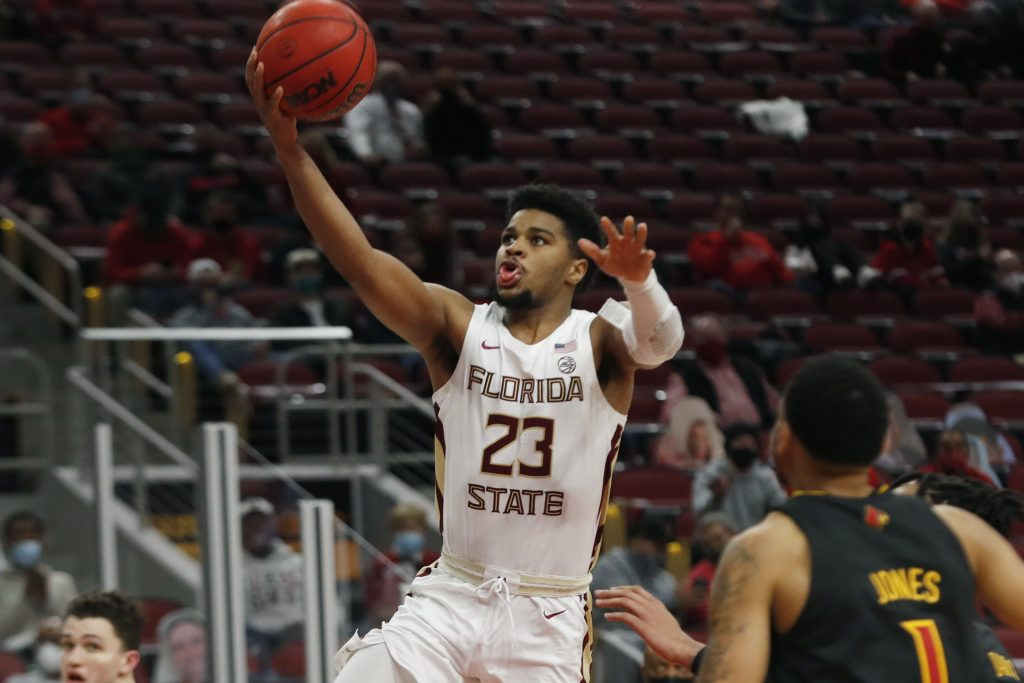 Florida State Seminoles guard MJ Walker (23) goes up for a shot against the Louisville Cardinal at KFC Yum! Center