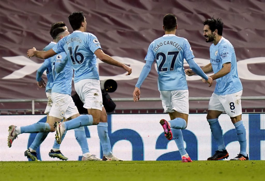 2/7/2021 - Manchester City's Ilkay Gundogan (right) celebrates scoring their side's second goal of the game during the Premier League match at Anfield, Liverpool. Picture date: Sunday February 7, 2021.