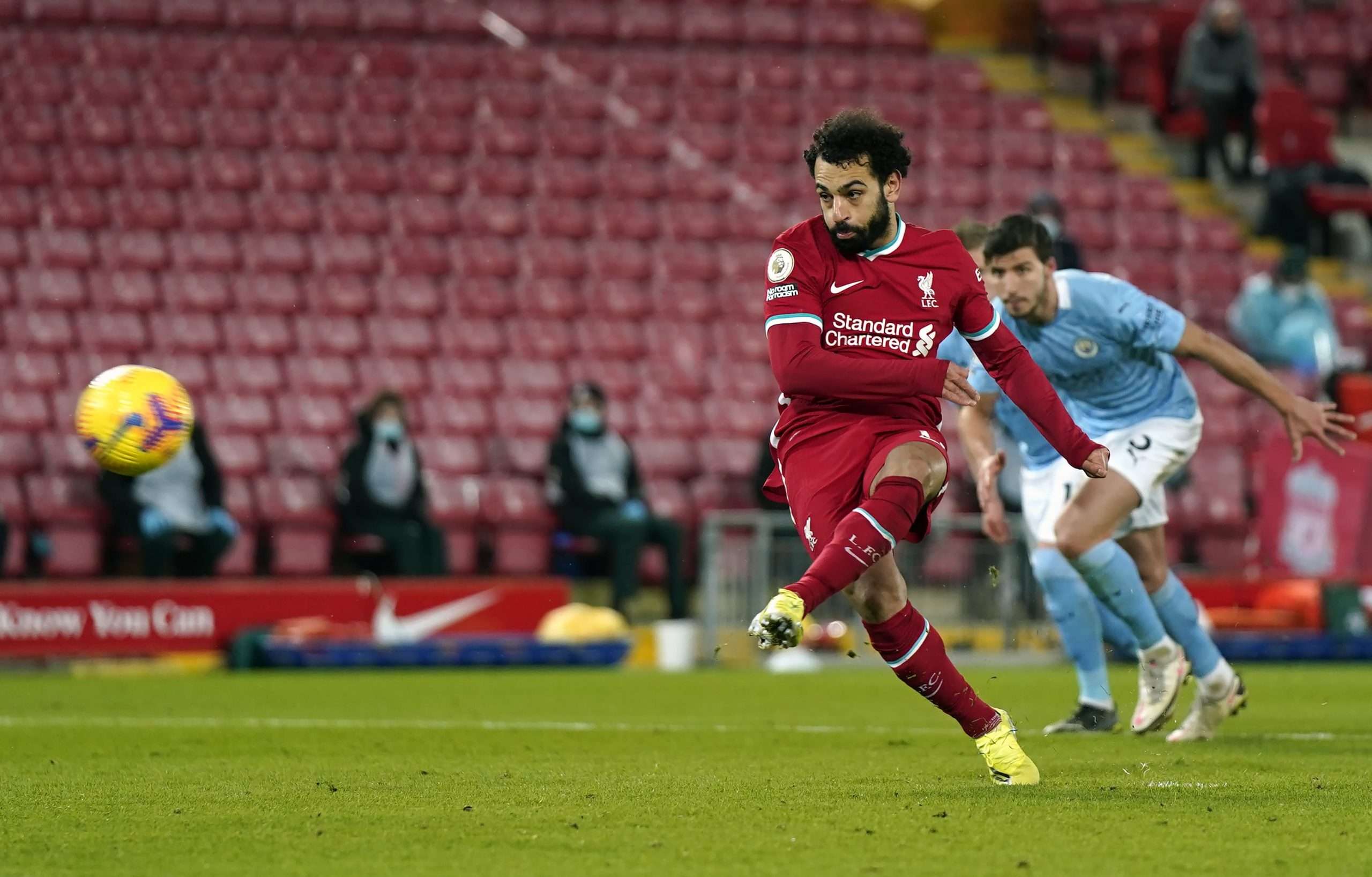 2/7/2021 - Liverpool's Mohamed Salah scores their side's first goal of the game from a penalty during the Premier League match at Anfield, Liverpool. Picture date: Sunday February 7, 2021.