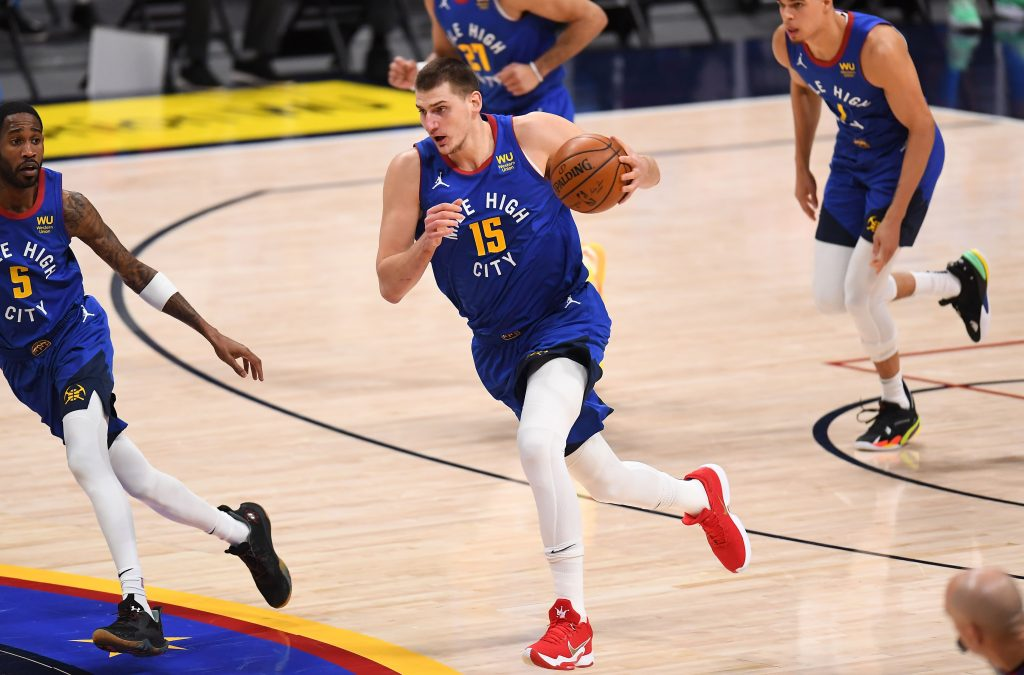 Denver Nuggets center Nikola Jokic (15) drives up court after intercepting a pass against the Oklahoma City Thunder in the second quarter at Ball Arena