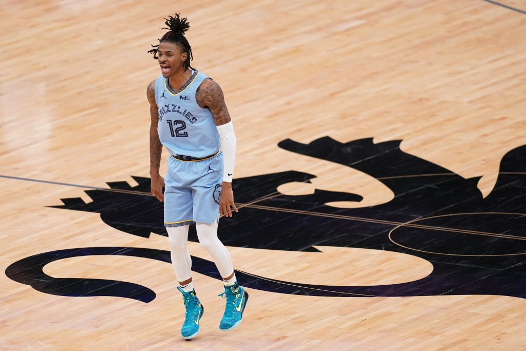 Memphis Grizzlies guard Ja Morant (12) reacts after the Grizzles scored a basket against the Sacramento Kings in the fourth quarter at the Golden 1 Center