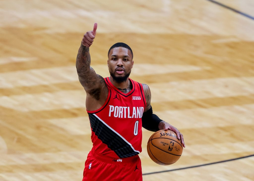 Feb 17, 2021; New Orleans, Louisiana, USA; Portland Trail Blazers guard Damian Lillard (0) calls a play against New Orleans Pelicans during the first half at the Smoothie King Center