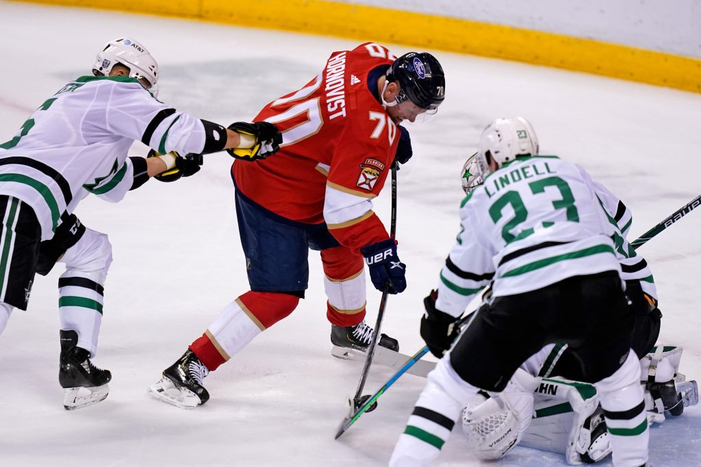 Florida Panthers Patric Hornqvist battles for the puck with Dallas Stars Esa Lindell