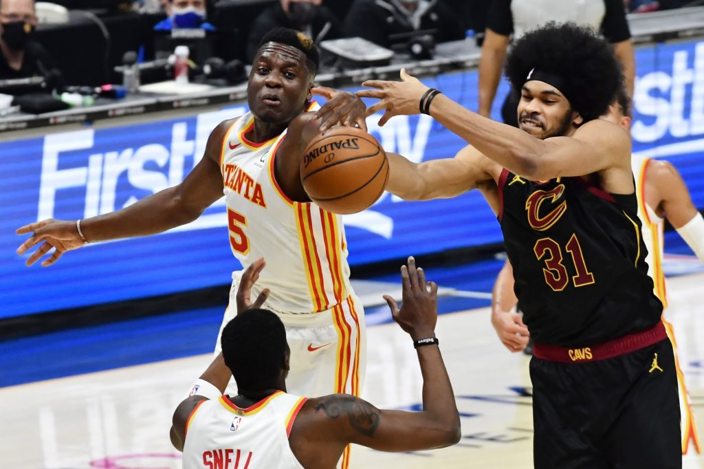 Cleveland Cavaliers center Jarrett Allen (31) goes for a rebound against Atlanta Hawks center Clint Capela (15) and guard Tony Snell (19) during the second quarter at Rocket Mortgage FieldHouse.