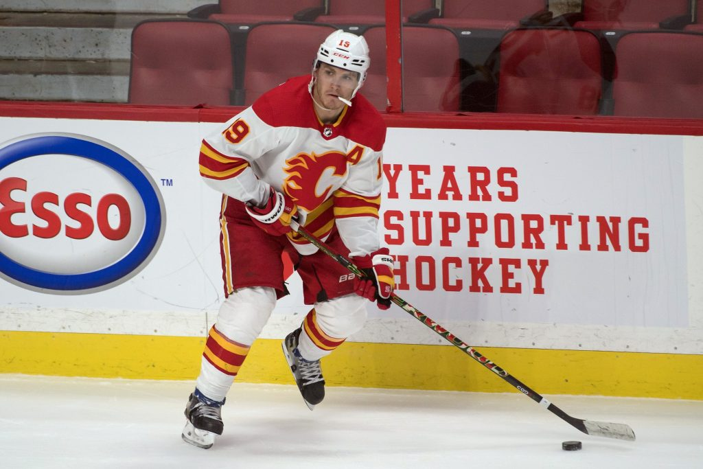 Calgary Flames left wing Matthew Tkachuk skates with puck.