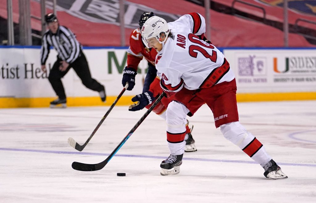 Mar 1, 2021; Sunrise, Florida, USA; Carolina Hurricanes right wing Sebastian Aho (20) controls the puck against the Florida Panthers during the first period at BB&T Center
