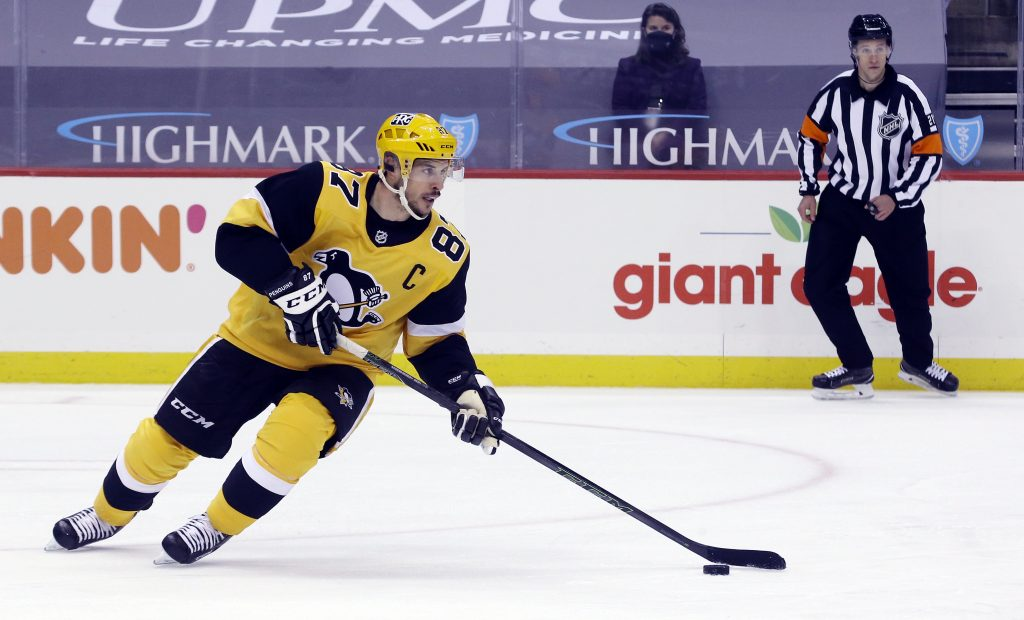 Mar 9, 2021; Pittsburgh, Pennsylvania, USA; Pittsburgh Penguins center Sidney Crosby (87) skates with the puck against the New York Rangers during the third period at PPG Paints Arena.
