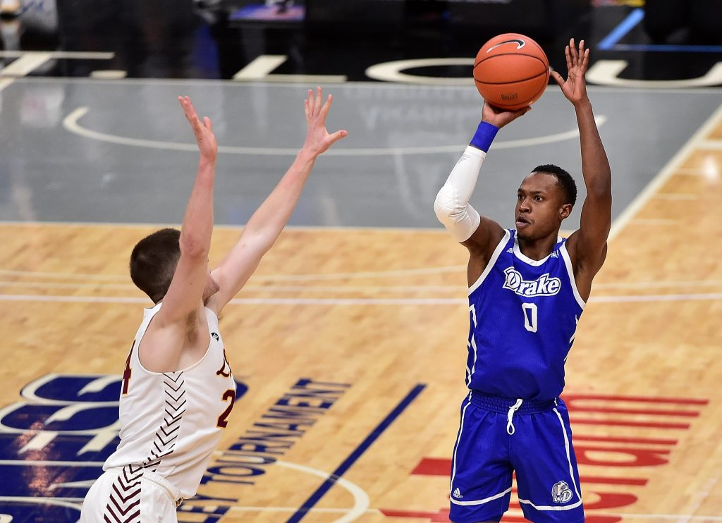 Drake Bulldogs guard D.J. Wilkins (0) shoots as Loyola Ramblers guard Tate Hall (24) defends during the first half in the finals of the Missouri Valley Conference Tournament at Enterprise Center