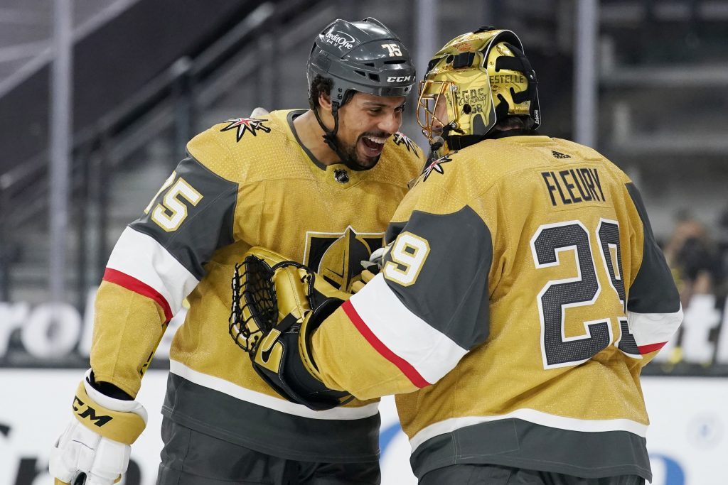 Vegas Golden Knights goaltender Marc-Andre Fleury celebrates after a goal by right wing Ryan Reaves