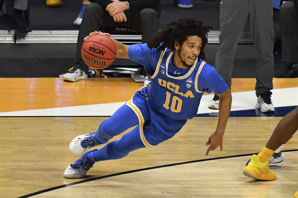 UCLA Bruins guard Tyger Campbell (10) dribbles the ball against the Brigham Young Cougars during the first round of the 2021 NCAA Tournament at Hinkle Fieldhouse
