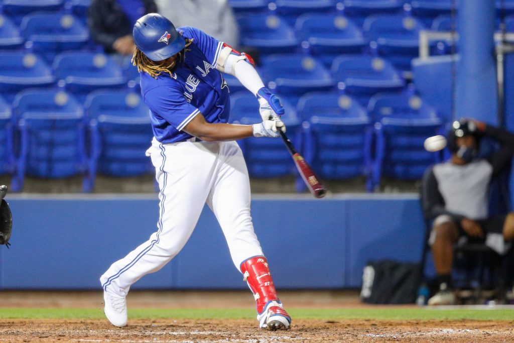 Toronto Blue Jays designated hitter Vladimir Guerrero Jr. (27) doubles in the sixth inning during spring training at TD Ballpark.