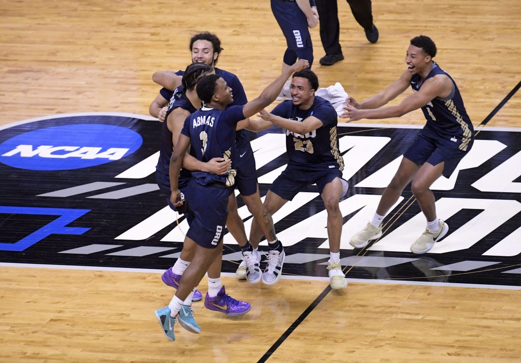 Oral Roberts Golden Eagles celebrate their 81-78 victory over the Florida Gators during the second round of the 2021 NCAA Tournament on Sunday, March 21, 2021, at Indiana Farmers Coliseum in Indianapolis.