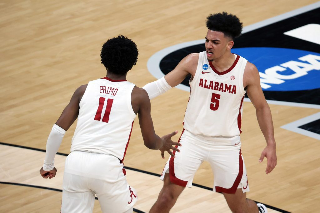 Alabama Crimson Tide guard Jaden Shackelford (5) and guard Joshua Primo (11) react after a play against the Maryland Terrapins in the second half in the second round of the 2021 NCAA Tournament.