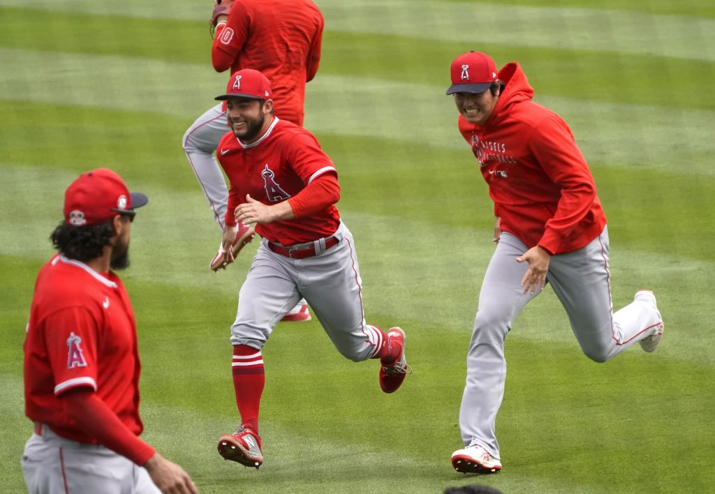 Los Angeles Angels designated hitter Shohei Ohtani (17) jokes around with third baseman David Fletcher (22) before a spring training game against the Colorado Rockies at Salt River Fields at Talking Stick.