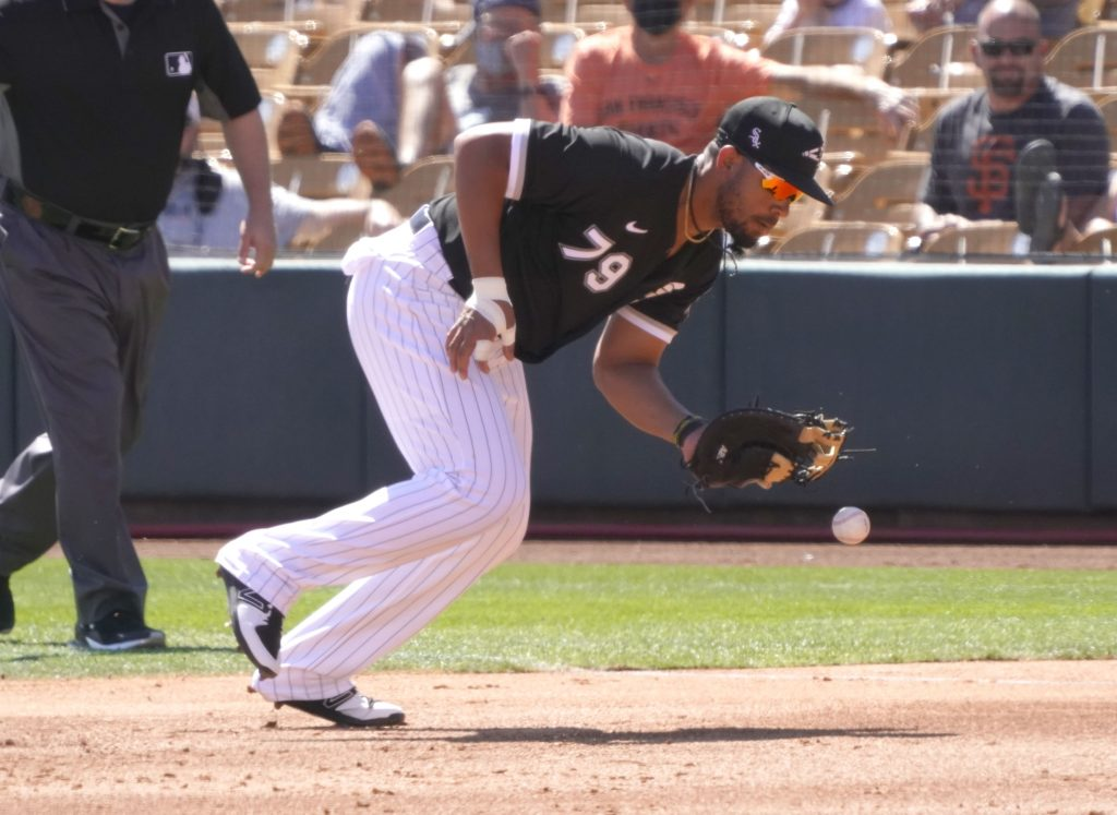 Chicago White Sox first baseman Jose Abreu (79) makes the play for an out against the San Francisco Giants during a spring training game at Camelback Ranch