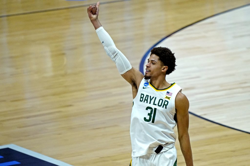 Baylor Bears guard MaCio Teague (31) celebrates after making a three point basket during the second half against the Arkansas Razorbacks in the Elite Eight of the 2021 NCAA Tournament at Lucas Oil Stadium