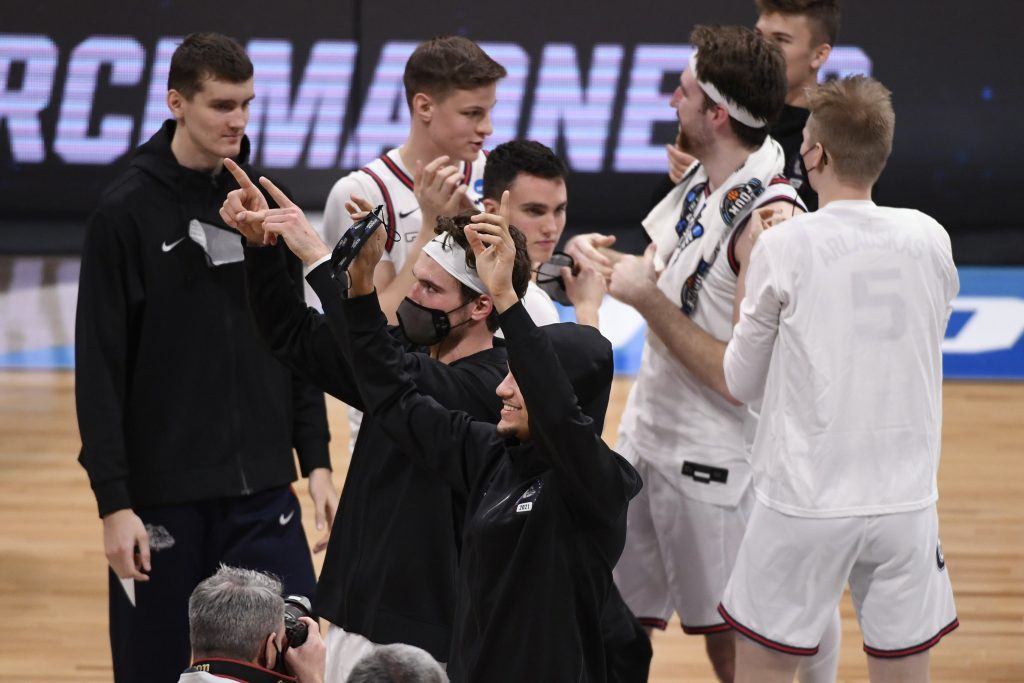 The Gonzaga Bulldogs celebrate after defeating the Creighton Bluejays during the Sweet 16 of the 2021 NCAA Tournament at Hinkle Fieldhouse