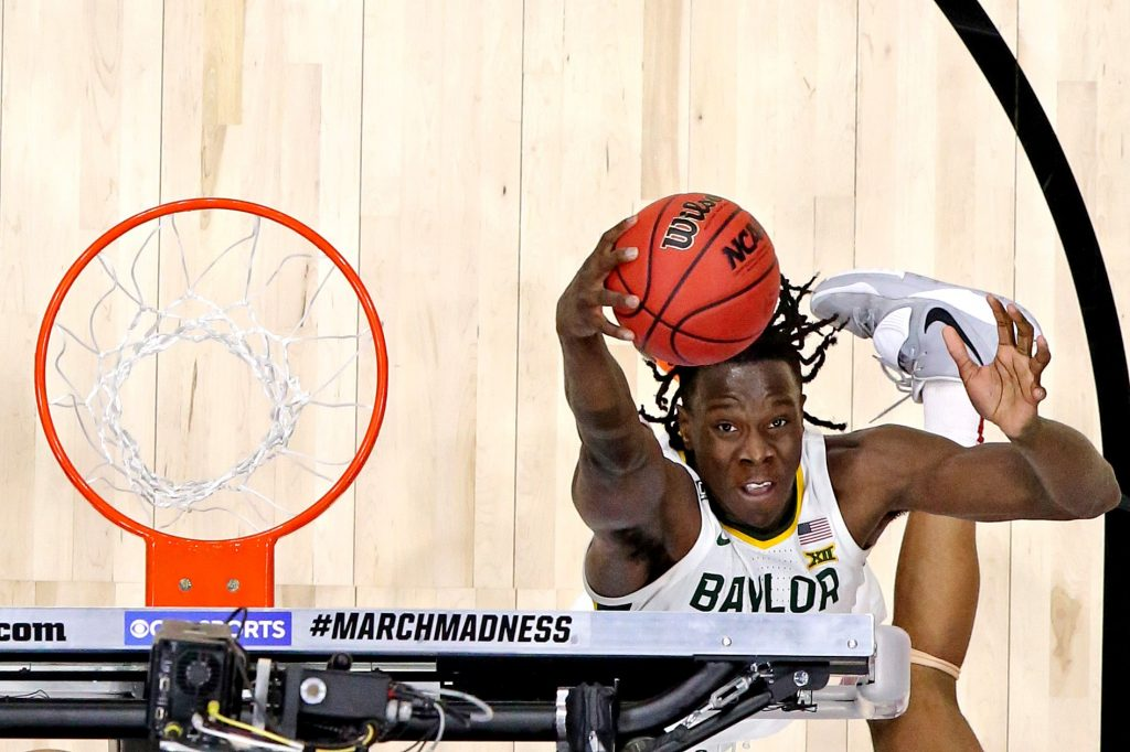 Baylor Bears forward Jonathan Tchamwa Tchatchoua (23) grabs a rebound during the second half against the Arkansas Razorbacks in the Elite Eight of the 2021 NCAA Tournament at Lucas Oil Stadium.