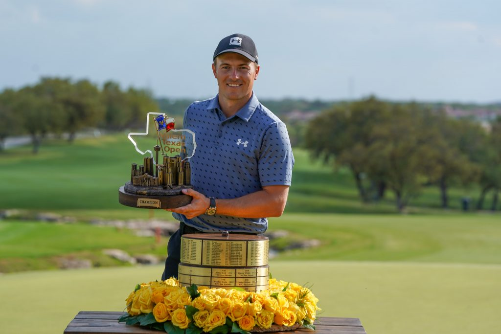 Jordan Spieth holds the trophy after winning the Valero Texas Open golf tournament.