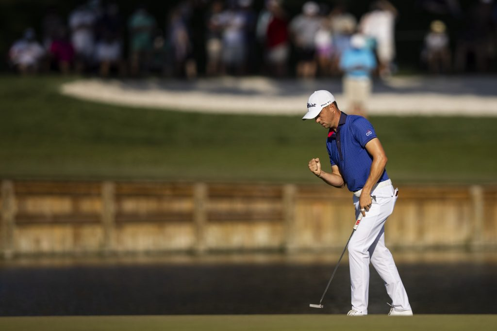 Justin Thomas reacts after sinking his putt on the 17th Green during the final round of The Players Championship at the Stadium Course at TPC Sawgrass on March 14, 2021 in Ponte Vedra Beach, Florida