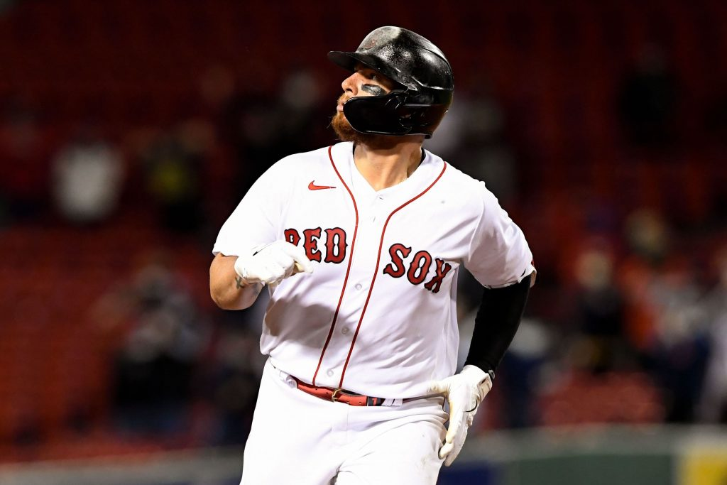 Boston Red Sox catcher Christian Vazquez (7) looks into the outfield after hitting a solo home run against the Tampa Bay Rays during the ninth inning at Fenway Park