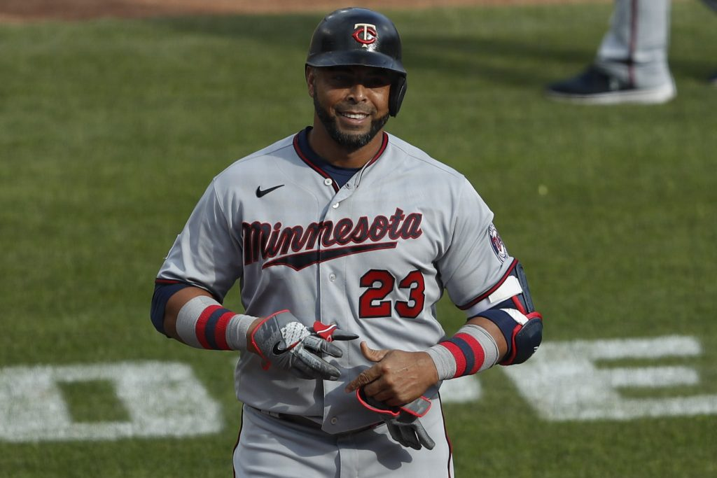 Minnesota Twins designated hitter Nelson Cruz (23) smiles as he walks off the field during the ninth inning against the Detroit Tigers at Comerica Park