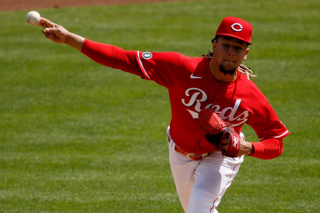 Cincinnati Reds starting pitcher Luis Castillo (58) throws a pitch in the third inning of the MLB National League game between the Cincinnati Reds and the Pittsburgh Pirates at Great American Ball Park in downtown Cincinnati on Wednesday, April 7, 2021