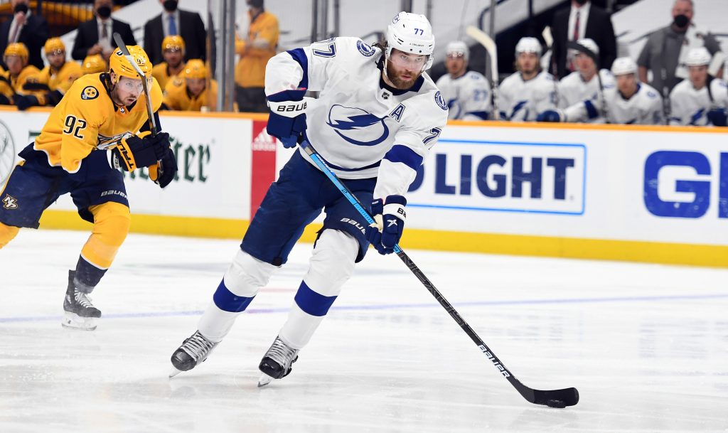 Apr 10, 2021; Nashville, Tennessee, USA; Tampa Bay Lightning defenseman Victor Hedman (77) passes the puck into the offensive zone against the Nashville Predators during the second period at Bridgestone Arena.