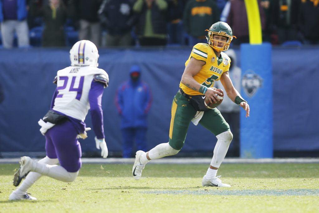 North Dakota State Bison quarterback Trey Lance (5) scrambles from James Madison Dukes safety D'Angelo Amos (24) in the third quarterat Toyota Stadium