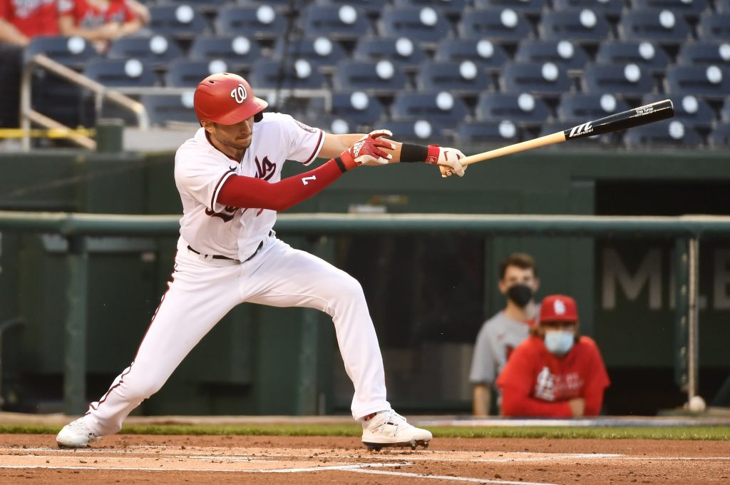 Washington Nationals shortstop Trea Turner (7) hits a single against the St. Louis Cardinals during the first inning at Nationals Park