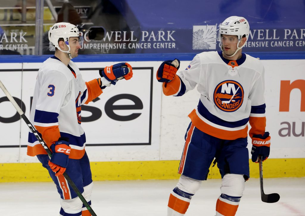 New York Islanders right wing Oliver Wahlstrom celebrates his goal with defenseman Adam Pelech