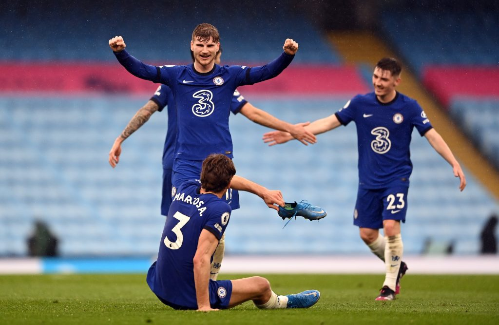 Chelsea's Timo Werner celebrates with match winning goalscorer team-mate Marcos Alonso after the Premier League match at the Etihad Stadium, Manchester.