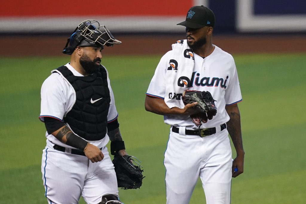 May 4, 2021; Miami, Florida, USA; Miami Marlins catcher Sandy Leon (L) and Miami Marlins starting pitcher Sandy Alcantara (R) walk to the dugout prior to the game against the Arizona Diamondbacks a at loanDepot park. Mandatory Credit: Jasen Vinlove-USA TODAY Sports