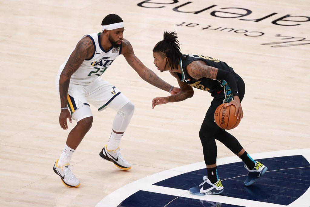 Memphis Grizzlies guard Ja Morant (12) controls the ball against Utah Jazz forward Royce O'Neale (23) during the fourth quarter at Vivint Arena. Memphis Grizzlies won 112-109.