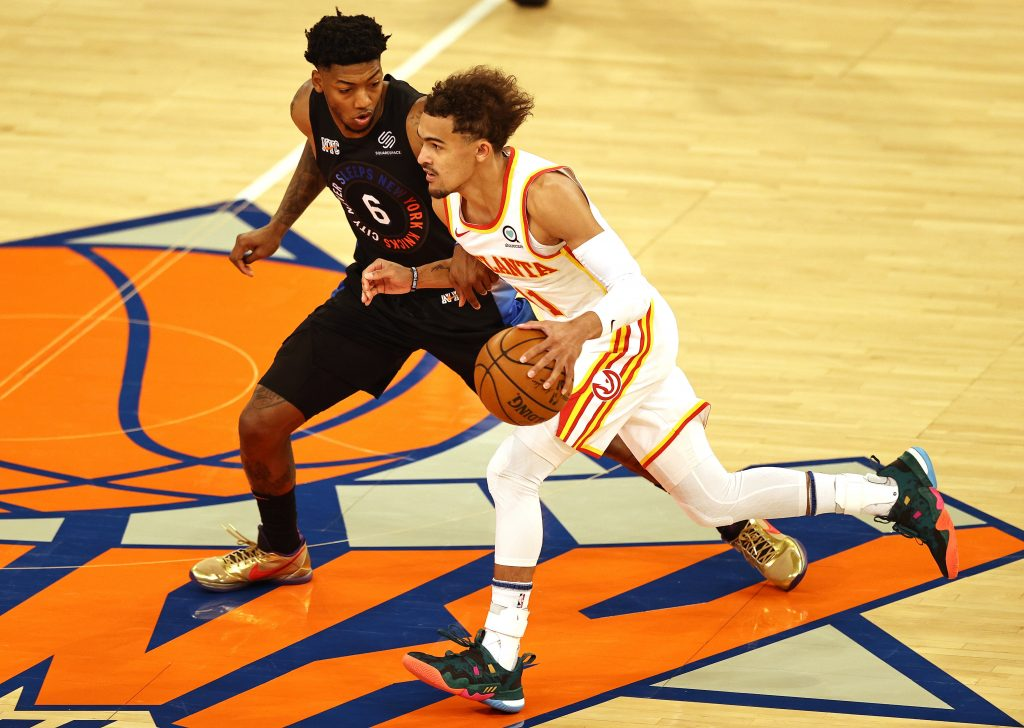 Atlanta Hawks guard Trae Young (11) moves the ball against New York Knicks guard Elfrid Payton (6) during the first half of game two of the Eastern Conference quarterfinal at Madison Square Garden