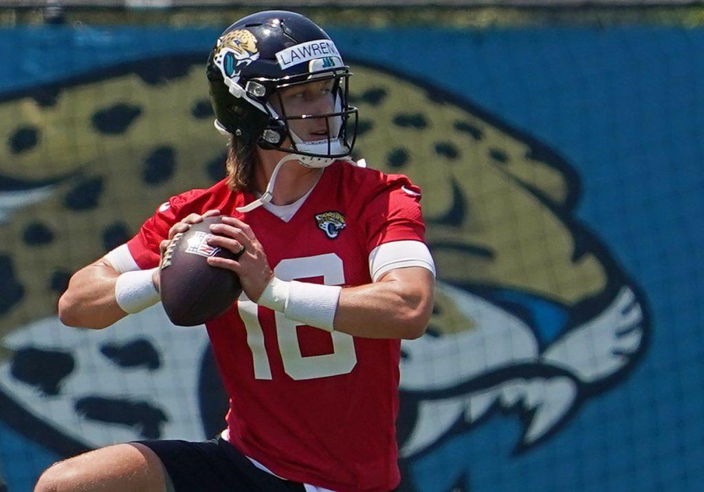Jacksonville Jaguars quarterback Trevor Lawrence (16) participates in drills during OTA at the Dream Finders Homes Practice Complex.