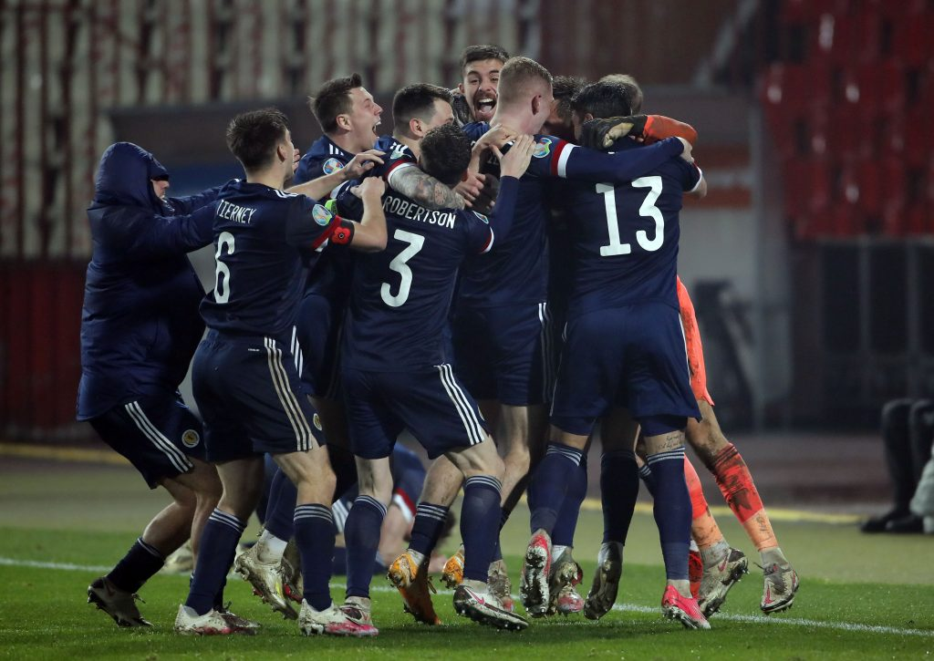 Scotland's players celebrate victory after the UEFA EURO2020 qualifying football match between Serbia and Scotland at the Rajko Mitic stadium in Belgrade, Serbia.