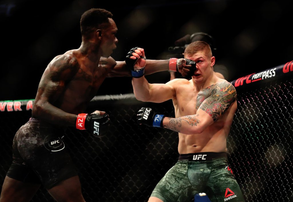 Israel Adesanya (red gloves) fights against Marvin Vettori (blue gloves) during UFC Fight Night at Gila River Arena.