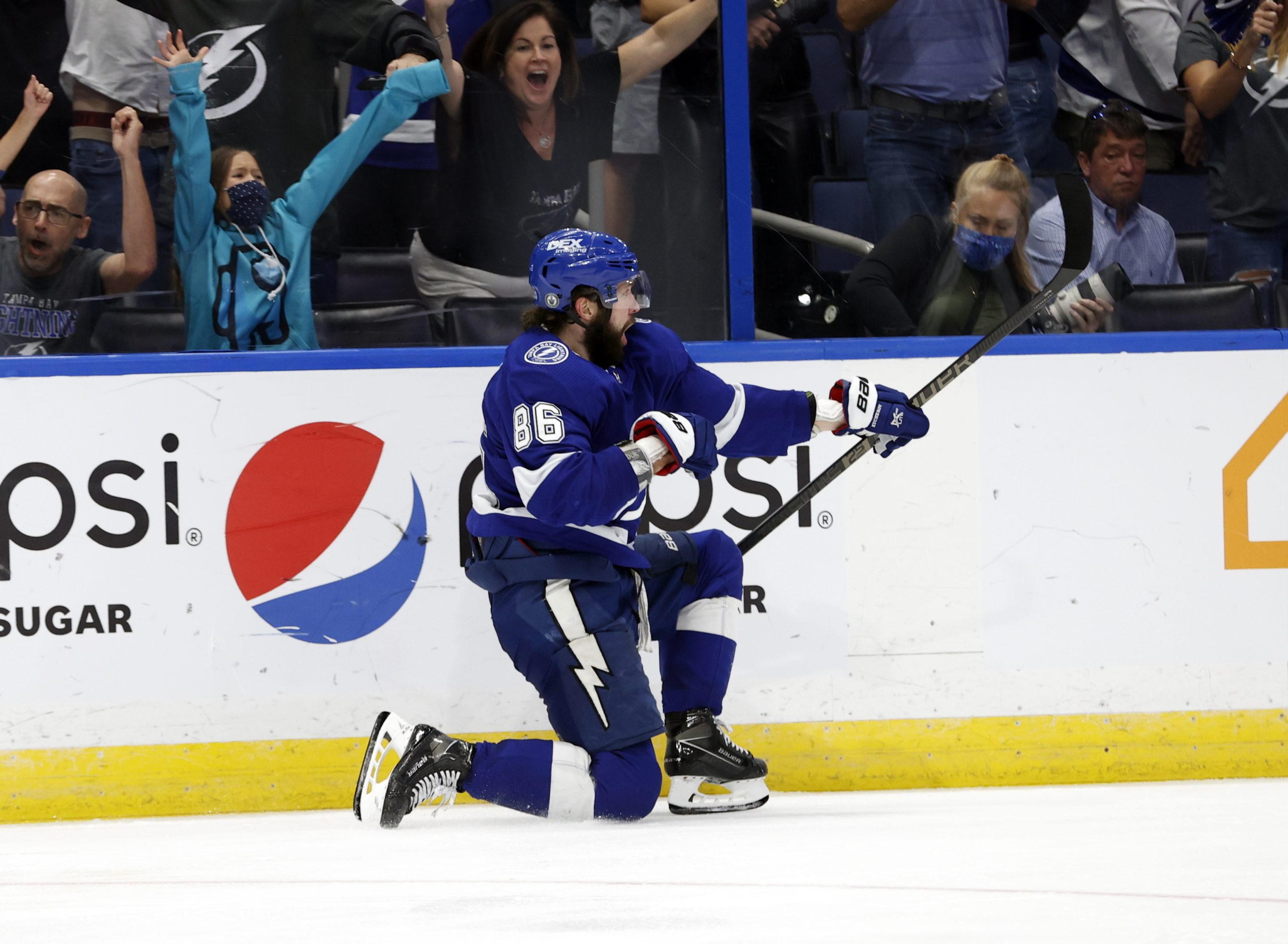 Jun 5, 2021; Tampa, Florida, USA; Tampa Bay Lightning right wing Nikita Kucherov (86) celebrates as he scores a goal against the Carolina Hurricanes during the third period in game four of the second round of the 2021 Stanley Cup Playoffs at Amalie Arena.