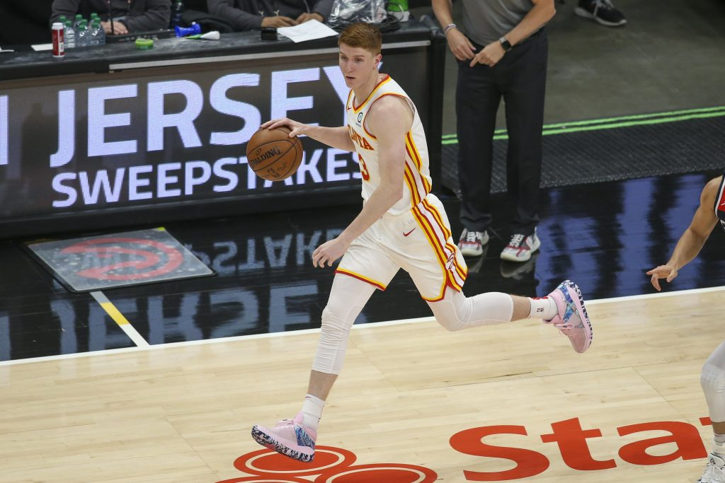 Atlanta Hawks guard Kevin Huerter (3) dribbles against the Washington Wizards in the second quarter at State Farm Arena