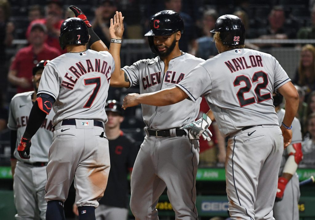Cleveland Indians batter Cesar Hernandez (7) is greeted at home after hitting a grand slam in the seventh inning against the Pittsburgh Pirates at PNC Park.
