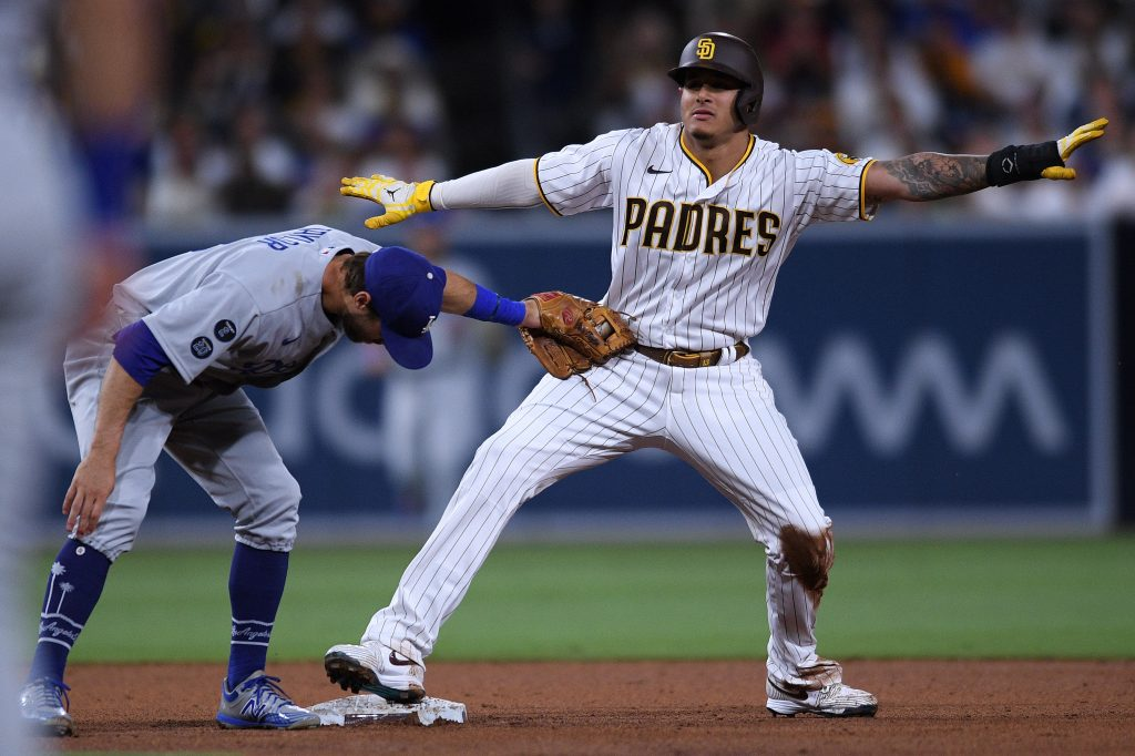 MLB: San Diego Padres third baseman Manny Machado (right) steals second base ahead of the tag by Los Angeles Dodgers second baseman Chris Taylor (left) during the fifth inning at Petco Park.