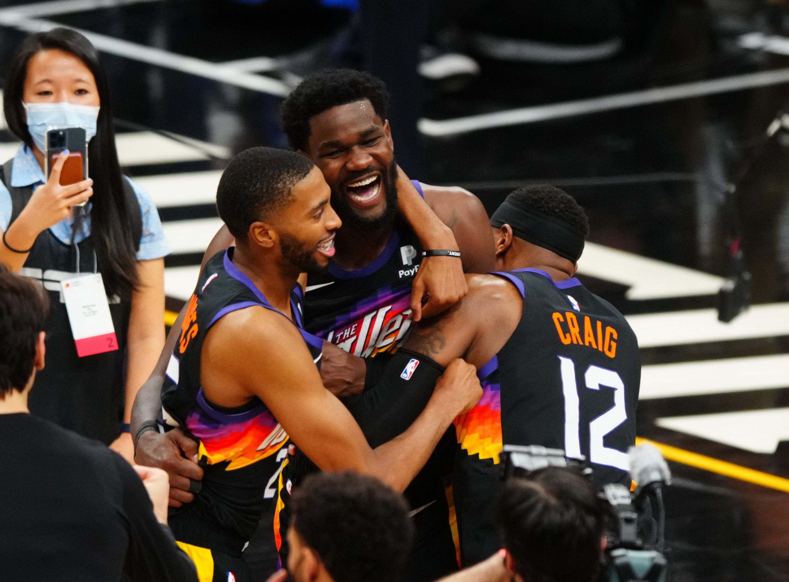 Phoenix Suns center Deandre Ayton (22) celebrates with teammates after scoring the game winning shot against the Los Angeles Clippers in the second half during game two of the Western Conference Finals for the 2021 NBA Playoffs at Phoenix Suns Arena