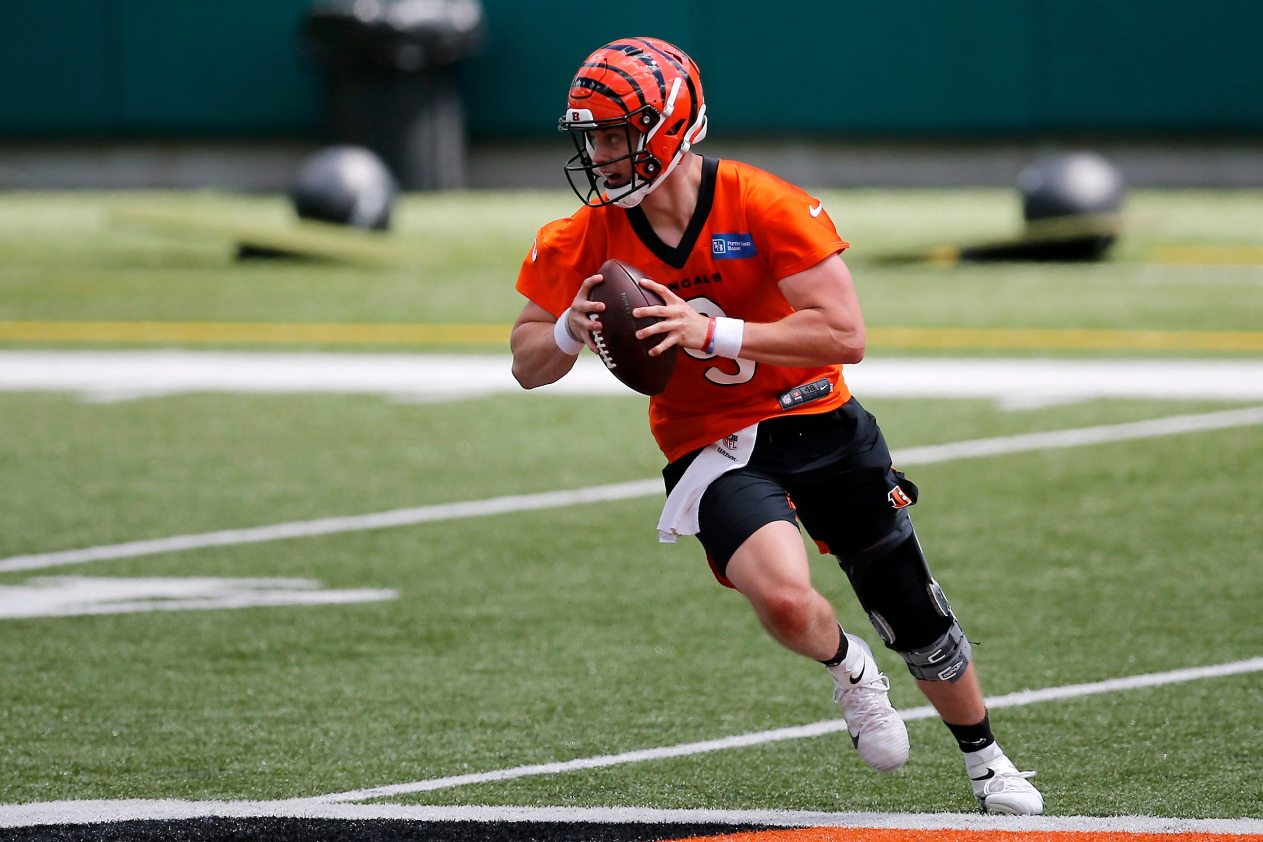 Bengals quarterback Joe Burrow scrambles during a minicamp practice at Paul Brown Stadium in Cincinnati on Tuesday. Cincinnati Bengals Mini Camp.