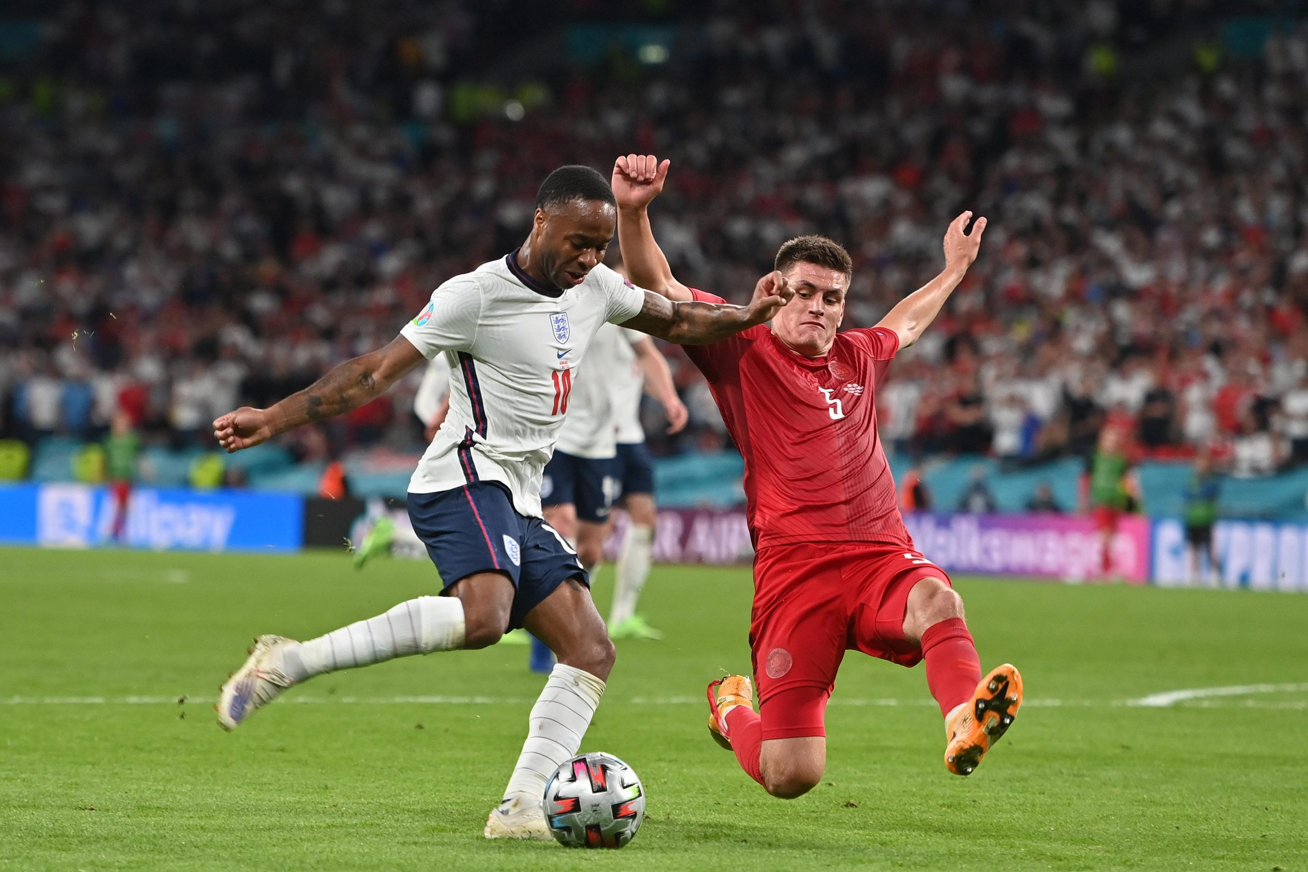 Raheem Sterling of England in action against Denmark at Euro 2020