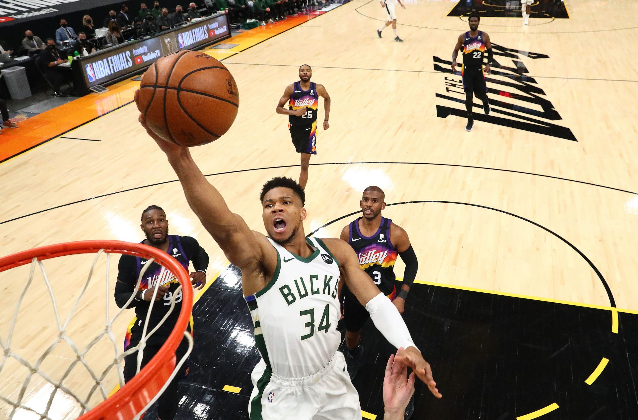 Milwaukee Bucks forward Giannis Antetokounmpo (34) drives to the basket against the Phoenix Suns during game two of the 2021 NBA Finals at Phoenix Suns Arena.