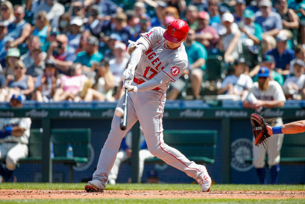Los Angeles Angels designated hitter Shohei Ohtani (17) makes contact with the ball against the Seattle Mariners during the fifth inning at T-Mobile Park