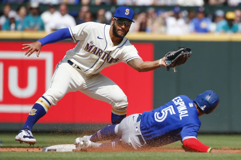 Toronto Blue Jays third baseman Santiago Espinal (5) steals second against Seattle Mariners second baseman Abraham Toro (13) during the fourth inning at T-Mobile Park